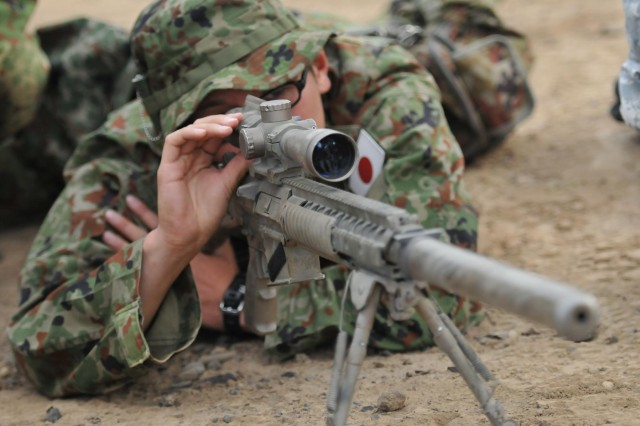 Japanese Sgt. Youhei Kaminota, sniper, 16th Regimental Combat Team, 4th Division, Japan Ground Self Defense Force, positions himself behind an M24 sniper rifle to familiarize himself before firing. The members of the Japan Ground Self-Defense Force took part in a combined training exercise with American snipers in which both forces learned from each other Sept. 5, at the Yakima Training Center, Wash. Both forces will exchange their knowledge of how they conduct sniper operations and will focus on target detection, reconnaissance techniques and cover and concealment. The combined training is part of Operation Rising Thunder 13, a three-week training exercise between soldiers from I Corps and the 16th RCT, designed to develop all war-fighting functions for both Japanese and U.S. forces.