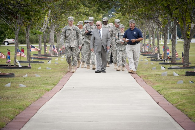 Under Secretary of the Army Dr. Joseph W. Westphal pays his respects at Warriors Walk, which honors the fallen Soldiers of the 3rd Infantry Division and attached units, who served in Operation Iraqi Freedom, Operation New Dawn, and Operation Enduring Freedom, at Fort Stewart, Ga., Sept. 5, 2013. Soldiers are memorialized with an Eastern Redbud tree planted in their honor.  The purpose of Westphal's visit was to underscore the versatility of the force to posture for future requirements and as well as to highlight the concerns of senior Army leaders about the impact of fiscal constraints (furloughs) and reinforce the value/contributions of the Department of the Army Civilian workforce and their families.
