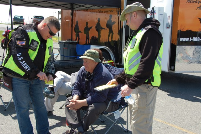 Army National Guard Lt. Col. Craig Lambert (center) coaches a fellow Soldier and Basic RiderCourse student at the West Virginia motorcycle training site in Summersville, W.V. Lambert and fellow RiderCoach Trainers have trained and mentored more that 1,000 riders and 150 RiderCoaches since the program began in 2005. Courtesy U.S. Army photo