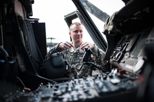 U.S. Army Reserve Chief Warrant Officer 2 Denver Gillham prepares his equipment before a training flight on a UH-60 Black Hawk helicopter at Simmons Army Airfield, Fort Bragg, N.C., Aug. 29, 2013. Gillham has been an aviation warrant officer since 2009, after being an enlisted Soldier with another career field. The Army Reserve is looking to fill hundreds of warrant officer positions in both the aviation and non-aviation career fields.