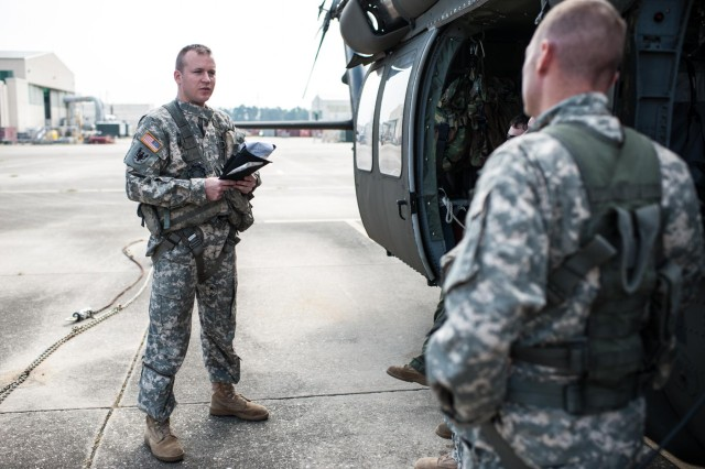 U.S. Army Reserve Chief Warrant Officer 2 Denver Gillham (left) conducts a pre-flight safety brief for a UH-60 Black Hawk helicopter at Simmons Army Airfield, Fort Bragg, N.C., Aug. 29, 2013. Gillham has been an aviation warrant officer since 2009, after being an enlisted Soldier with another career field. The Army Reserve is looking to fill hundreds of warrant officer positions in both the aviation and non-aviation career fields.