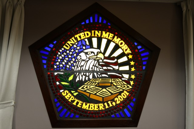 "A stained glass window in the front of the Pentagon Memorial Chapel is designed like the ""Survivor's Pin"" that was given to each of the 9/11 survivors at the Pentagon."