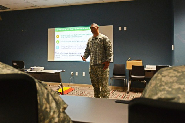 Sgt. 1st Class Darin Elkins provides instruction on the first day of the Performance Triad pilot at Joint Base Lewis-McChord, Wash. Elkins works at the Rehabilitation and Reintegration Division of the Army Surgeon General's Office in Falls Church, Va.