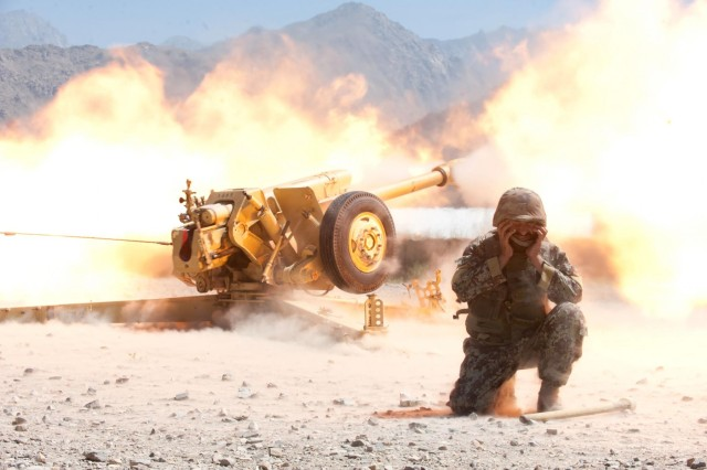 An Afghan National Army (ANA) soldier with 4th Battalion, 3rd Brigade, 201st Corps, braces himself while a D-30 122 mm howitzer fires during certification exercises at Forward Operating Base Tagab, Kapisa province, Afghanistan, Sept. 5, 2013. U.S. Soldiers with Bravo Battery, 5th Battalion, 25th Field Artillery Regiment, 4th Brigade Combat Team, 10th Mountain Division, trained and certified the ANA throughout eastern Afghanistan advising and instructing ANA artillery soldiers on the proper handling of D-30s, a Soviet-made heavy artillery weapon capable of engaging targets more than 15 kilometers away.  (U.S. Army National Guard photo by Sgt. Margaret Taylor/Released)