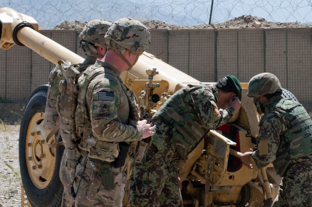 "KAPISA PROVINCE, Afghanistan "" U.S. Army Soldiers (left) from Battery B, 5th Battalion, 25th Field Artillery Regiment, 4th Brigade Combat Team, 10th Mountain Division, observe Afghan National Army soldiers from 4th Kandak, 3rd Brigade, 201st Corps, loading a D-30 122 mm howitzer during certification exercises at Forward Operating Base Tagab, Kapisa Province, Afghanistan, Sept. 5, 2013. Battery B, stationed in FOB Gamberi in Laghman Province, goes throughout eastern Afghanistan advising and instructing ANA howitzer crews on the proper handling of D-30s, a Soviet-made heavy artillery weapon capable of engaging targets more than 15 kilometers away. (U.S. Army National Guard photo by Sgt. Margaret Taylor, 129th Mobile Public Affairs Detachment/RELEASED)"
