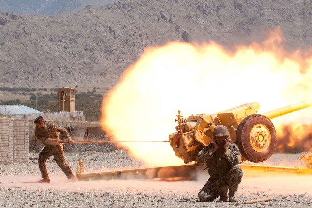 "KAPISA PROVINCE, Afghanistan "" An Afghan National Army fire support crew from 4th Kandak, 3rd Brigade, 201st Corps, fires a D-30 122 mm howitzer during certification exercises at Forward Operating Base Tagab, Kapisa Province, Afghanistan, Sept. 5, 2013. U.S. Army Soldiers from Battery B, 5th Battalion, 25th Field Artillery Regiment, 4th Brigade Combat Team, 10th Mountain Division, traveled from FOB Gamberi in Laghman Province to check on training and certify the ANA D-30 howitzer crews at Tagab. Battery B goes throughout eastern Afghanistan advising and instructing ANA artillery soldiers on the proper handling of D-30s, a Soviet-made heavy artillery weapon capable of engaging targets more than 15 kilometers away.  (U.S. Army National Guard photo by Sgt. Margaret Taylor, 129th Mobile Public Affairs Detachment/RELEASED)"