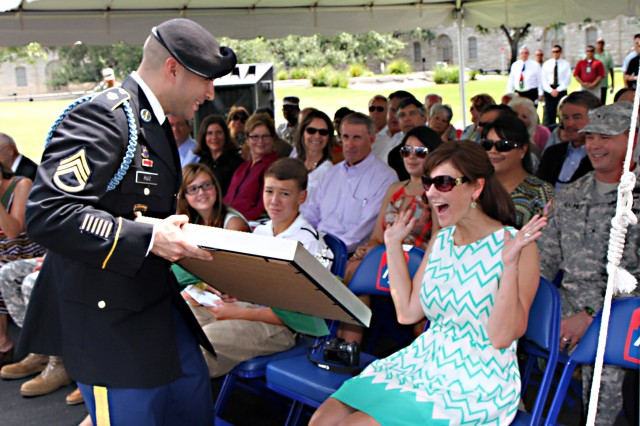 "FORT SAM HOUSTON, Texas "" Stephanie Caldwell, wife of Lt. Gen. William Caldwell IV, the outgoing commanding general of U.S. Army North (Fifth Army), reacts with surprise as Staff Sgt. Jason Ruiz, Headquarters Support Company, Headquarters and Headquarters Battalion, Army North, presents her with a Yellow Rose of Texas on behalf of Army North during the change of command ceremony held Sept. 4 in the historic Quadrangle.  (U.S. Army photo by Staff Sgt. Corey Baltos, Army North PAO)"