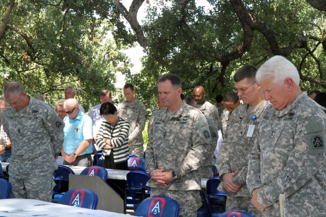 "FORT SAM HOUSTON, Texas "" Members of the U.S. Army North (Fifth Army) leadership join their fellow Soldiers and civilians in prayer during the Army North prayer luncheon Sept. 5 in the historic Quadrangle. The luncheon, which took place the day after the unit's change of command ceremony, was designed to bring people together to share prayer, fellowship and food. ""It is good we are gathering at the beginning of this command tour "" to pray for our new commanding general and the success of our work, mission and people,"" said Col. Gary Studniewski, command chaplain, Army North. Pictured in the front row are Command Sgt. Maj. Hu Rhodes (left), Army North senior enlisted leader; Lt. Gen. Perry Wiggins, commanding general of Army North and senior commander of Fort Sam Houston and Camp Bullis; Col. Keith Detwiler, chief of staff, Army North; and Maj. Gen. Charles Gailes Jr., commanding general, Task Force 51, Army North. (U.S. Army photo by Staff Sgt. Corey Baltos, Army North PAO)"