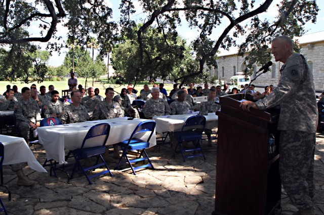 "FORT SAM HOUSTON, Texas "" Col. Gary Studniewski, command chaplain, U.S. Army North (Fifth Army) opens the unit's prayer luncheon Sept. 5 in the historic Quadrangle by reminding those assembled why they gathered together. ""This event is a gift to come together and share food and prayer,"" he said. (U.S. Army photo by Staff Sgt. Corey Baltos, Army North PAO)"