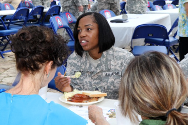 "FORT SAM HOUSTON, Texas "" Staff Sgt. Carla Philpot, a chaplain assistant with U.S. Army North (Fifth Army), talks to her fellow Army North teammates during the unit's prayer luncheon Sept. 5 in the historic Quadrangle. The event provided members of the Army North community the opportunity to gather in fellowship and prayer and enjoy good food together. (U.S. Army photo by Staff Sgt. Corey Baltos, Army North PAO)"