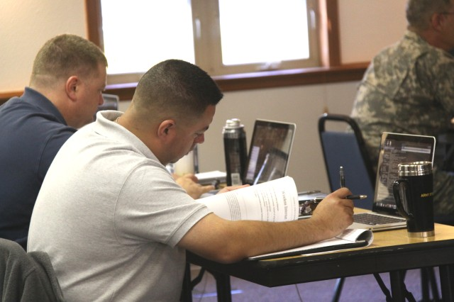 Staff Sgt. Marcos Jimenez, a Soldier with the Warrior Transition Battalion at Joint Base Lewis-McChord, Wash., takes part in a digital forensics course at Camp Murray, Wash., on Aug. 21, 2013.