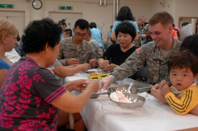 Among many foods, a Korean traditional rice cake called Songpyeon is the most popular food during Chuseok. Soldiers from Headquarters and Headquarters Company USAG Yongsan make Songpyeon with local elders, Sept. 11. (U.S. Army photo by Cpl. Lim Hong-seo)