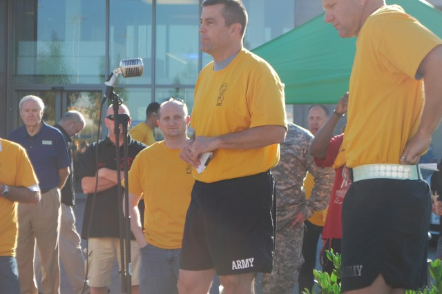 Col. Christopher M. Benson, USAG Ansbach commander, talks about the importance of suicide awareness prior to the second annual Suicide Prevention Awareness Run/Walk at the Urlas Post Exchange parking lot Sept. 6. USAG Ansbach Army Substance Abuse Program organized the run in coordination with the Directorate of Family and Morale, Welfare and Recreation.
