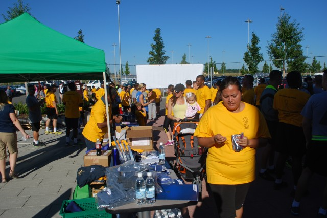 Rosa Ramirez, foreground, Army spouse, gets a juice from the organizers of the 3-kilometer Suicide Prevention Awareness Run/Walk Sept. 6. The second annual run/walk was sponsored by USAG Ansbach's Army Substance Abuse Program to raise awareness of suicide prevention.