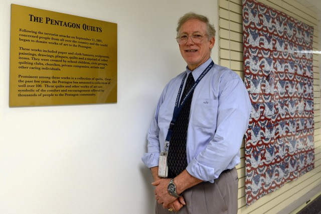 Albert L. Jones, curator of the Office of the Secretary of Defense Historical Exhibits, stands in the hallway where the Pentagon quilts are on display, Sept. 10, 2013.