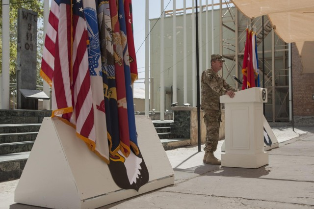 Maj. Gen. James C. McConville, commanding general, Combined Joint Task Force 101, speaks to coalition service members during a ceremony on the twelfth anniversary of the 9/11 terrorist attacks in front of the World Trade Center Memorial at Bagram Airfield, Afghanistan Sept. 11, 2013. The audience gathered to remember the more than 3,000 who perished on that horrific day and honor the sacrifice and dedication to freedom of the more than 5,300 service members who have perished fighting the war on terror. (U.S. Army National Guard photo by Spc. Ryan Scott, 129th Mobile Public Affairs Detachment/RELEASED)