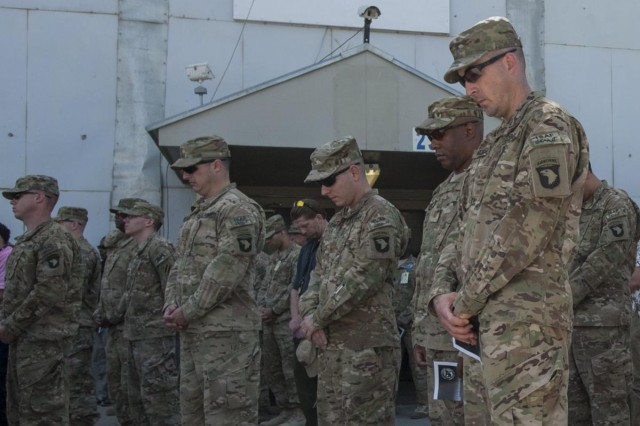 Coalition service members observe a moment of silence during a ceremony on the twelfth anniversary of the 9/11 terrorist attacks in front of the World Trade Center Memorial at Bagram Air Field, Afghanistan Sept. 11, 2013. The audience gathered to remember the more than 3,000 who perished on that horrific day and honor the sacrifice and dedication to freedom of the 5,311 service members who have perished fighting the war on terror. (U.S. Army National Guard photo by Spc. Ryan Scott, 129th Mobile Public Affairs Detachment/RELEASED)