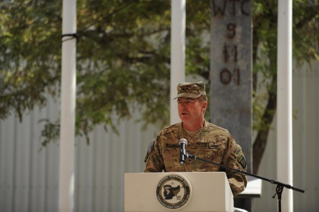 U.S. Army Maj. Gen. James C. McConville, the commanding general of Combined Joint Task Force 101, speaks to coalition Service members during a ceremony on the twelfth anniversary of the 9/11 terrorist attacks, in front of the World Trade Center Memorial at Bagram Airfield, Afghanistan, Sept. 11, 2013. The audience gathered to remember the more than 3,000 who perished that day and to honor the sacrifice and dedication to freedom of the more than 5,300 Service members who have perished fighting the war on terror. (U.S. Army National Guard photo by Maj. Wayne Asscherick/Released)
