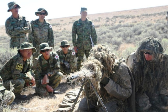 U.S. Army Spc. Joseph Biasatti, center, and Spc. Peter Churchill, right, demonstrate advanced sniper techniques to soldiers with the Japan Ground Self-Defense Force, during Rising Thunder at the Yakima Training Center, Wash., Sept. 10, 2013. Rising Thunder is a U.S. Army-hosted exercise designed to build interoperability between I Corps, the 7th Infantry Division and the Japan Ground Self-Defense Force.  (U.S. Army photo by Staff Sgt. Mark Miranda/Released)
