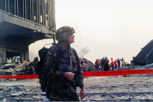 New York Army National Guard Spc. Christian Miller from Company C, 1st Battalion, 105th Infantry, surveys ground zero devastation Sept. 13, 2001, two days after the 9/11 terror attacks.