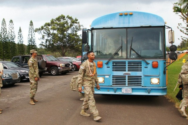1st Lt. Rashia King (left) and Staff Sgt. Jonathan Diaz (center), both with Co. A, 307th ESB, 516th Sig. Bde., 311th Sig. Cmd. (Theater) welcome the final group of Co. A Soldiers back to the unit and a redeployment ceremony at the battalion Dining Facility on Helemano Military Reservation, Sep. 5, following their nine-month Afghanistan mission.