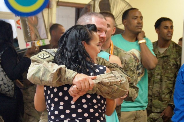 Sgt. Jacob Wheeler, Co. A, 307th ESB, 516th Sig. Bde., 411th Sig. Command (Theater) and wife, Cindy, embrace at 307th ESB Dining Facility on Helemano Military Reservation, Sep. 5 , following the unit's redeployment ceremony.  Co. A Soldiers were deployed to Afghanistan for nine months.