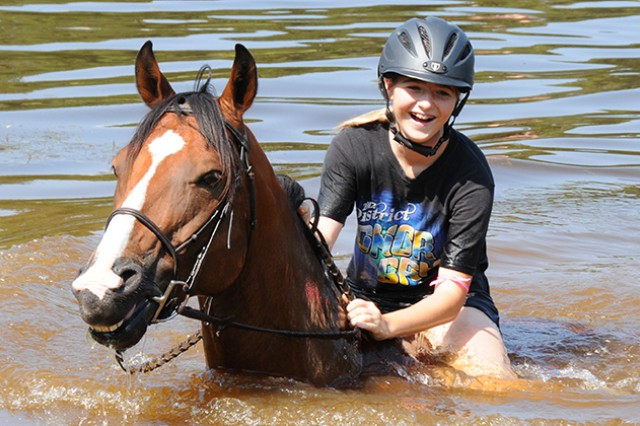 Rylie Benehan, military Family member, takes her horse, Spanky, for a swim in Buckhorn Lake during Ride, Swim, BBQ Sept. 7.