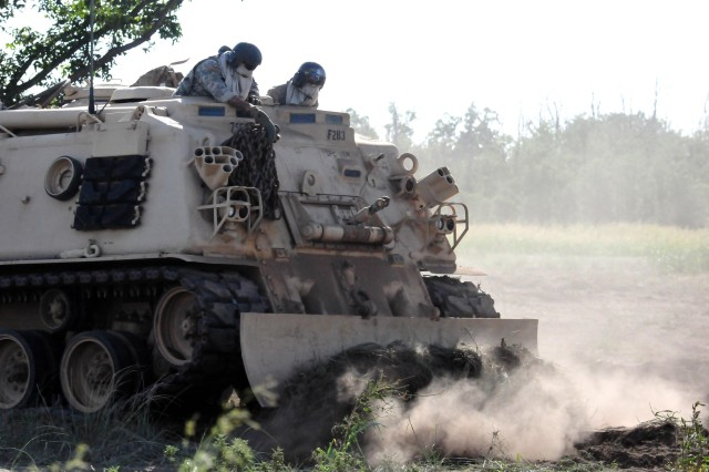 Third Battalion, 13th Field Artillery Soldiers cover a firing point with dirt after the battalion completed its MLRS crew certification field exercise Aug. 29 at Fort Sill.