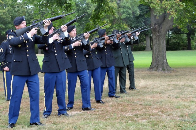 A seven-member detail fires three volleys during the Rock Island Arsenal, Ill., 9/11 Dedication & Remembrance Ceremony, Sept. 11, 2013.
