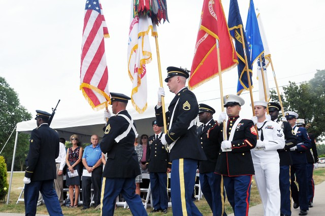 Members of the Joint Color Guard march to their position during the 9/11 Dedication & Remembrance Ceremony at Rock Island Arsenal, Ill., Sept. 11, 2013.