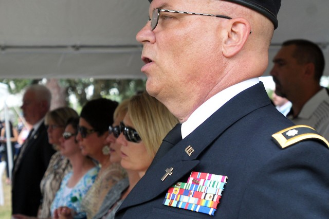 "Chaplain (Lt. Col.) Robert Land, ASC, and attendees sing ""America the Beautiful"" during the 9/11 Dedication & Remembrance Ceremony at Rock Island Arsenal, Ill., Sept. 11, 2013. Land gave the invocation earlier in the ceremony."