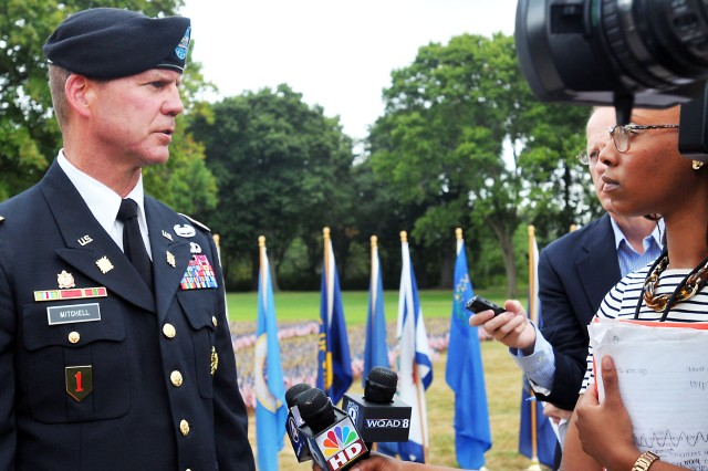 Col. Daniel Mitchell (left), deputy commanding officer, Army Sustainment Command, takes questions from the local media following the 9/11 Dedication & Remembrance Ceremony at Rock Island Arsenal, Ill., Sept. 11, 2013.