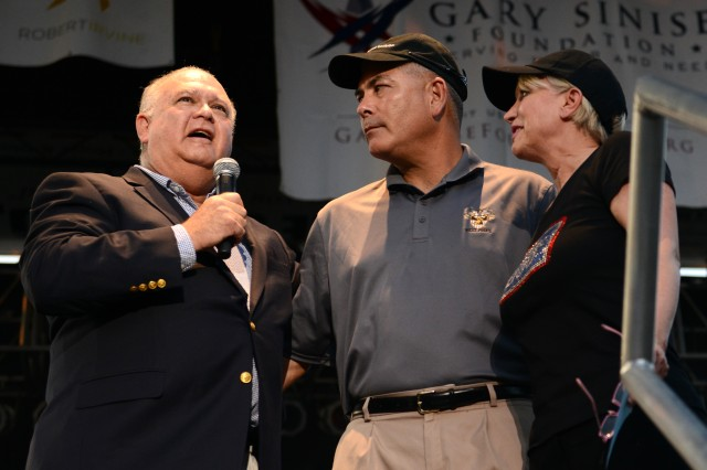 "Under Secretary Dr. Joseph W. Westphal, Vice Chief of Staff Gen. John F. Campbell and Elaine Rogers, president and CEO of USO of Metropolitan Washington, thank members of the military during the ""Invincible Spirit Festival"" at Fort Belvoir, Va., Sept. 11, 2013."