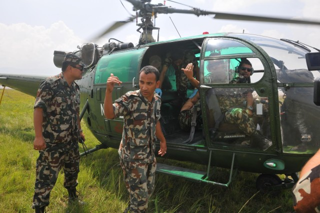 Participants in the Nepal Pacific Resilience Disaster Response Exercise & Exchange, or DREE, conduct search and rescue operations during the second day of the exercise, Sept. 10, 2013, in Kathmandu, Nepal. The DREE, co-hosted by the Nepalese army and U.S. Army Pacific, runs Sept. 9-12, and it is the first in Nepal to include a field training exercise designed to practically apply civil-military disaster preparedness and response initiatives when faced with a massive earthquake scenario.