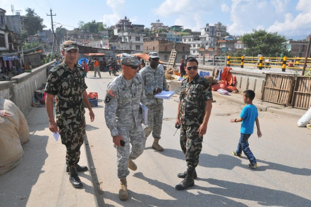 Participants in the Nepal Pacific Resilience Disaster Response Exercise & Exchange, or DREE, conduct engineering assessment operations during the second day of the exercise, Sept. 10, 2013, in Kathmandu, Nepal. The DREE, co-hosted by the Nepalese army and U.S. Army Pacific, runs Sept. 9-12, and it is the first in Nepal to include a field training exercise designed to practically apply civil-military disaster preparedness and response initiatives when faced with a massive earthquake scenario.