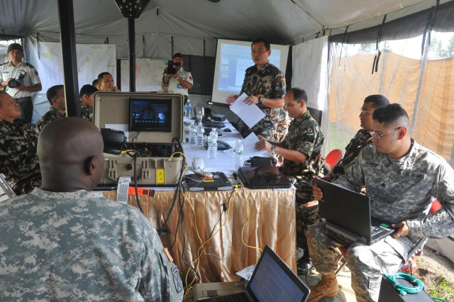 Participants and observers from Nepal, U.S., and international militaries and agencies gather Sept. 10 for the first day of the field training portion of the Nepal Pacific Resilience Disaster Response Exercise & Exchange in Kathmandu, Nepal. The DREE, co-hosted by the Nepalese army and U.S. Army Pacific, runs from Sept. 9-12, and it is the first in Nepal to include a field training exercise designed to practically apply civil-military disaster preparedness and response initiatives when faced with a massive earthquake scenario. (U.S. Army photo by Sgt. 1st Class Mary E. Ferguson, 8th Theater Sustainment Command Public Affairs/Released)