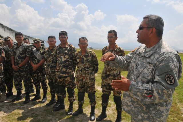 Participants in the Nepal Pacific Resilience Disaster Response Exercise & Exchange,or DREE, conduct an after-action review following search and rescue operations during the second day of the exercise, Sept. 10, 2013, in Kathmandu, Nepal. The DREE, co-hosted by the Nepalese army and U.S. Army Pacific, runs Sept. 9-12, and it is the first in Nepal to include a field training exercise designed to practically apply civil-military disaster preparedness and response initiatives when faced with a massive earthquake scenario.