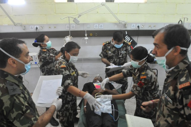 Participants in the Nepal Pacific Resilience Disaster Response Exercise & Exchange, or DREE, conduct a mass casualty medical drill at Birendra Army Hospital, during the third day of the exercise, Sept. 11, 2013, in Kathmandu, Nepal. The DREE, co-hosted by the Nepalese army and U.S. Army Pacific, runs Sept. 9-12, and it is the first in Nepal to include a field training exercise designed to practically apply civil-military disaster preparedness and response initiatives when faced with a massive earthquake scenario.