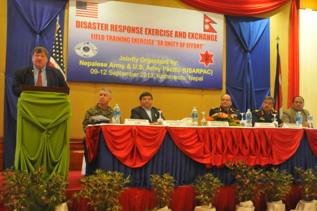Ambassador Peter Bodde from the U.S. Embassy in Nepal applauds the collaboration and dedication displayed throughout the Nepal Pacific Resilience Disaster Response Exercise & Exchange, or DREE, during his closing ceremony remarks, Sept. 12, 2013, in Kathmandu, Nepal. The DREE, co-hosted by the Nepalese army and U.S. Army Pacific, ran Sept. 9-12, and was the first in Nepal to include a field training exercise designed to practically apply civil-military disaster preparedness and response initiatives when faced with a massive earthquake scenario.