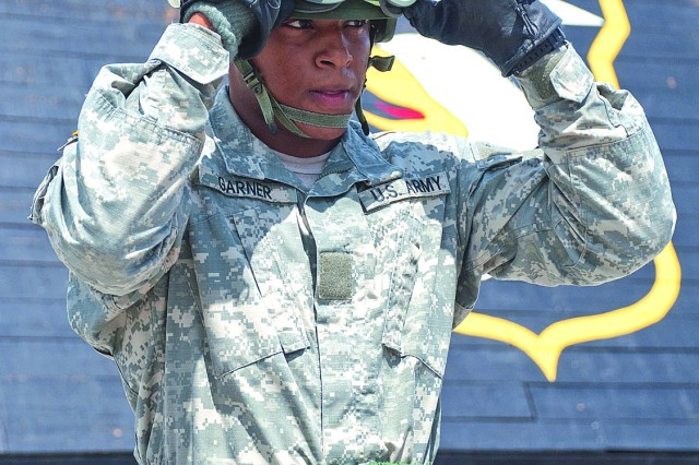 Cadet Jeff Garner secures his gear in preparation for a fast rope exercise at Fort Campbell's Sabalauski Air Assault School. Garner chronicled his days at Air Assault School to provide readers with a first-person perspective on the training received.
