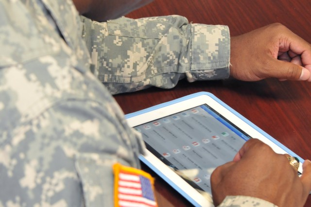 Sgt. 1st Class Mario Peete, on the U.S. Army Recruiting Command G-2 staff, reviews the file sharing app being used by recruiters to enhance knowledge management.