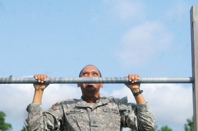 Pfc. Hanif Maragh, Juliet Company, 244th Quartermaster Battalion, pulls himself up over the pullup bar during his company's fitness challenge Aug. 30. More than 50 Soldiers participated in the event that served to boost morale by awarding priviledges prior to the Labor Day weekend.