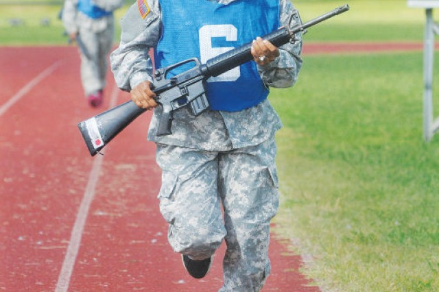 Pfc. Victoria Smith, Juliet Company, 244th Quartermaster Battalion, pushes toward the finish line during a weapons run Aug. 30. It was one of several competitive events that made up a pre-Labor Day weekend fitness challenge that awarded privileges based on performance