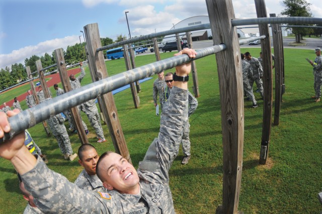 Pfc. Judson Godbold pauses before pulling himself over the pullup bar during the Juliet Company, 244th Quartermaster Battalion fitness challenge Aug. 30. The challenge was an incentive event in which the winning team was awarded certain priviledges. More than 50 students participated in the pre-Labor Day weekend event.
