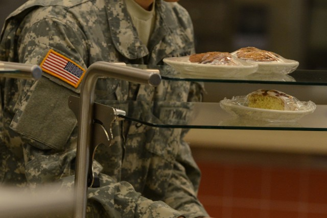 A Soldier at Joint Base Lewis-McChord, Wash., navigates below the pastries and greasy foods at a dining facility to load up on salad greens. Nutrition, along with sleep and activity, are the three prongs of Performance Triad.