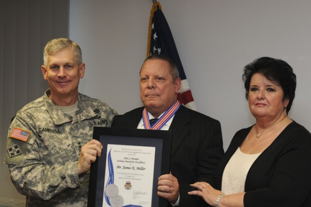 Lt. Gen. Donald M. Campbell Jr (left), commander, U.S. Army Europe, recognized James K. Miller (center), chief of the awards and actions branch, G1, USAREUR, with the John J. Dinnien Civilian Award for Excellence, Sept. 13.