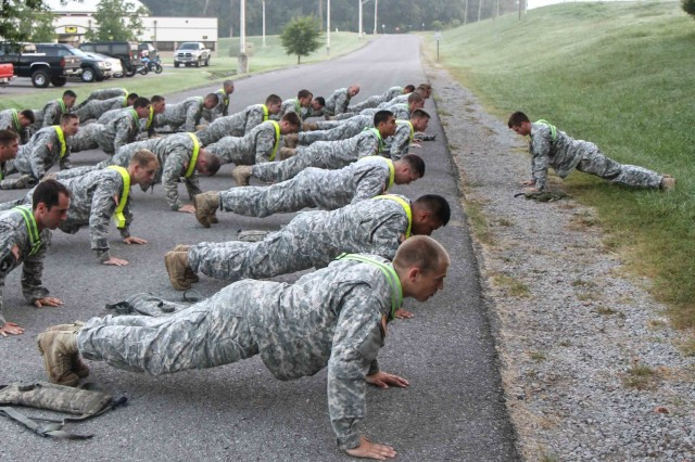 "FORT CAMPBELL, Ky., - Soldiers assigned to 1st Battalion, 187th Infantry Regiment, 3rd Brigade Combat Team ""Rakkasans,"" 101st Airborne Division (Air Assault), conduct a group push up exercise, Fort Campbell, Ky., August 28. The push up and other exercises were part of a warm up routine before advancing to the Sabalauski Air Assault School obstacle course. The Soldiers were part of a team-leader development course created by 1-187 to mentor the team leaders within the Battalion. (U.S. Army Photo by Spc. Brian Smith-Dutton 3BCT Public Affairs)"