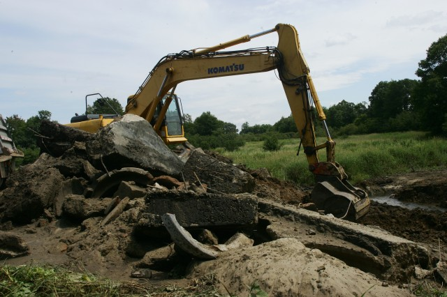 Personnel from the Wisconsin Department of Natural Resources and U.S. Fish and Wildlife Service work in conjunction with the Fisheries Program of the Fort McCoy Natural Resources Branch to remove a dam from WAC pond. Further work will be done to rehabilitate the stream banks to help improve fish passage and the flow of water.