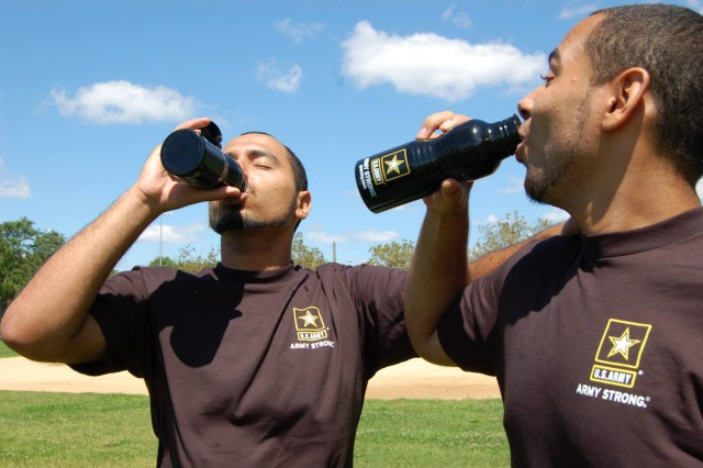 Taking a well-deserved hydration break, Edward and Jacob Maldonado, fraternal twins who enlisted together into the same military occupational specialty and who will attend both phases of their Initial Entry Training together, sip water after a tough workout together.