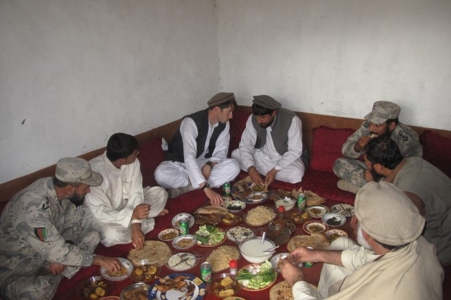 Capt. William Swenson has lunch with Afghan National Army local leadership and former Mujahadeen outside of Asadabad, Afghanistan, March 2009.